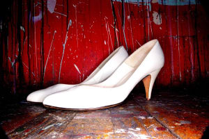 These are a pair of non-nondescript white heeled shoes. You'd forget about them next year for sure.