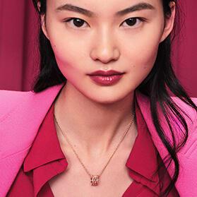 Model wearing B.zero1 rose gold pendant necklace with diamonds.