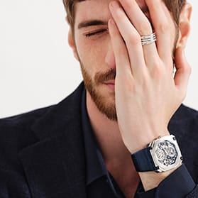 """""""Polaroid with the writing """"""""My pride"""""""" depicting a model with a hand on his face wearing an Octo Finissimo Tourbillon Skeleton watch and a B.zero1 ring. """""""