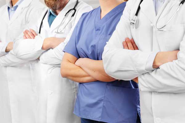 doctors-and-nurses-in-healthcare-team-with-arms