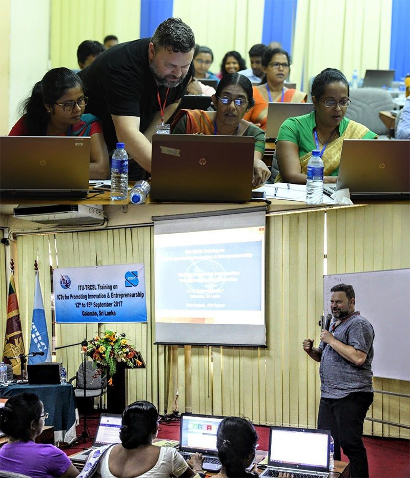 A photo of Pete Argent teaching and helping in a training program in Sri Lanka for the United Nations.