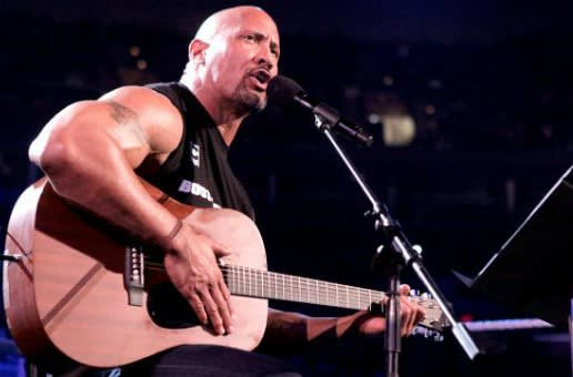 The Rock tocando violão