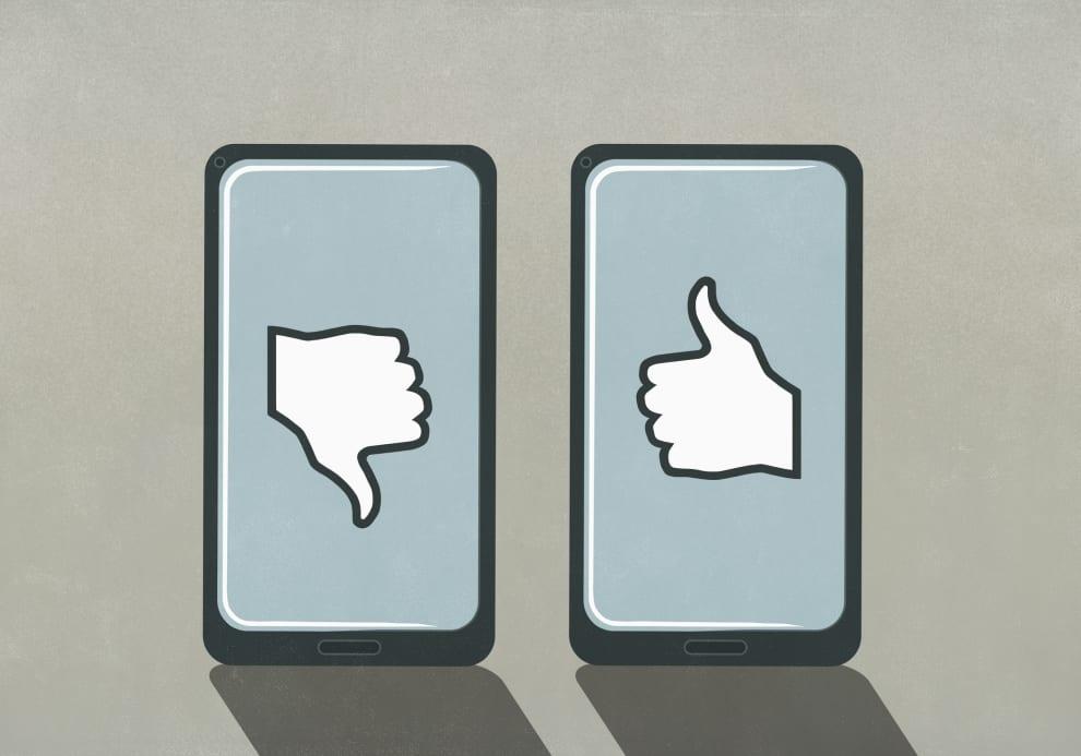 Ilustração mostra dois telefones celulares. Um deles mostra o ícone do like e o outro mostra o ícone de dislike