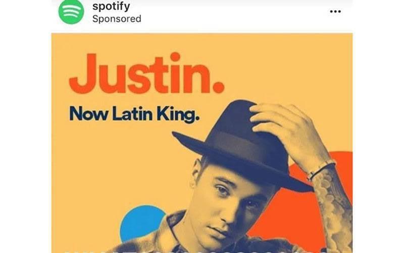 "Anúncio do Spotify com o texto ""Justin.  Now Latin King""."