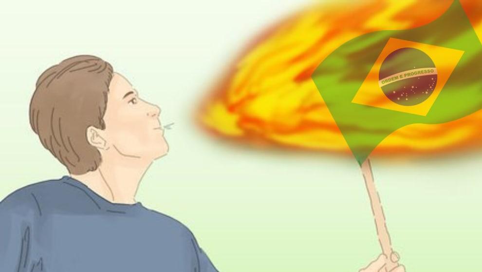 pessoa cuspindo fogo numa bandeira do Brasil