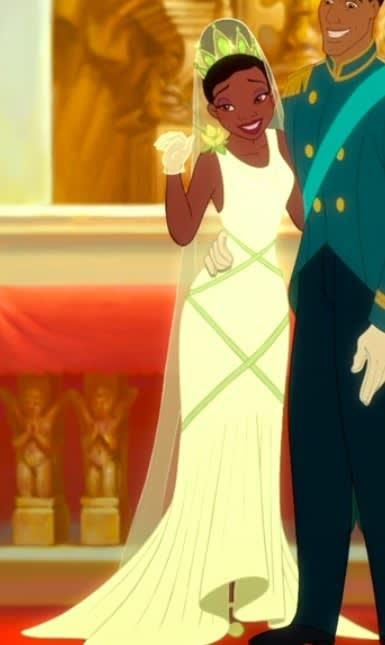 Tiana wears a fitted wedding dress