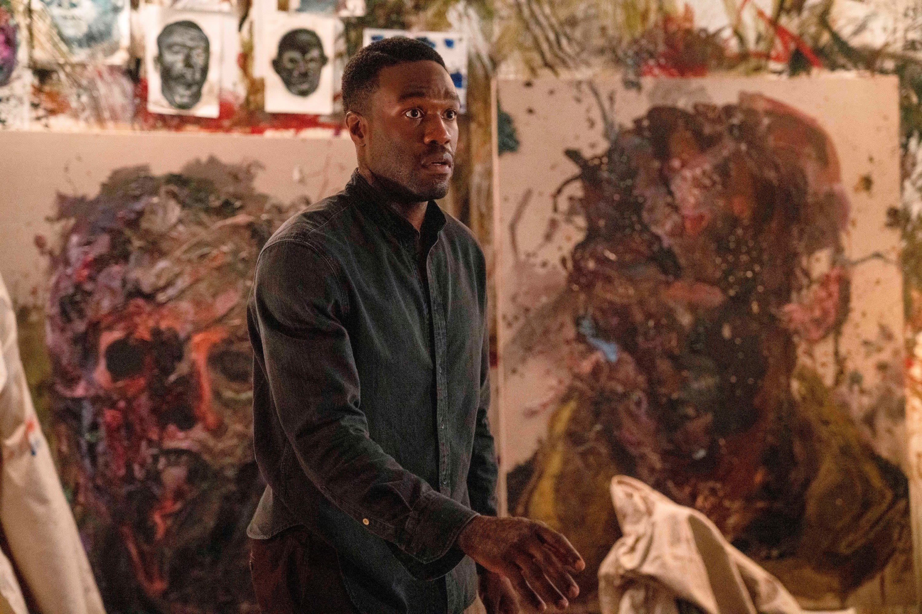 Yahya stands in front of paintings as Anthony in 'Candyman'