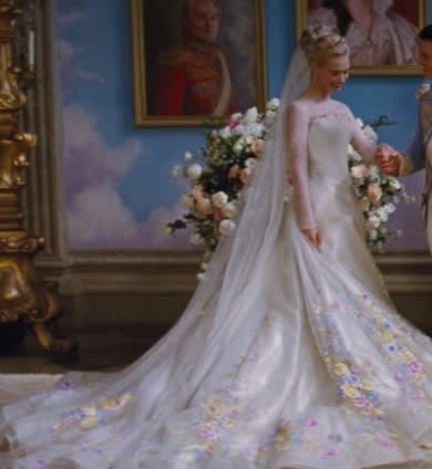 Cinderella poses in a wedding gown