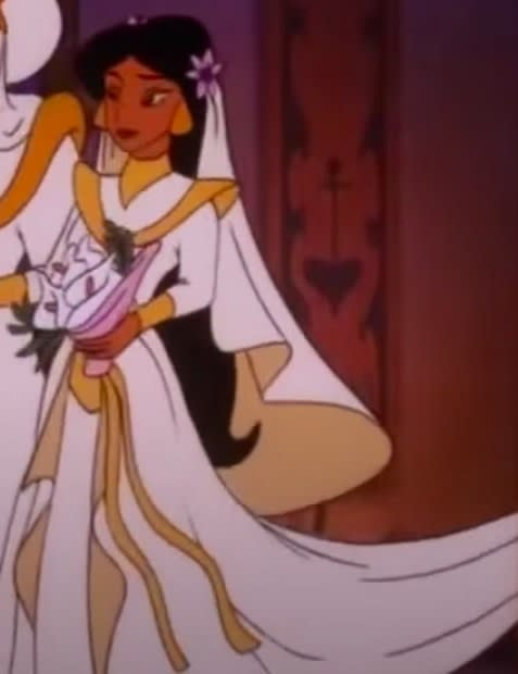 Jasmine wears a wedding outfit