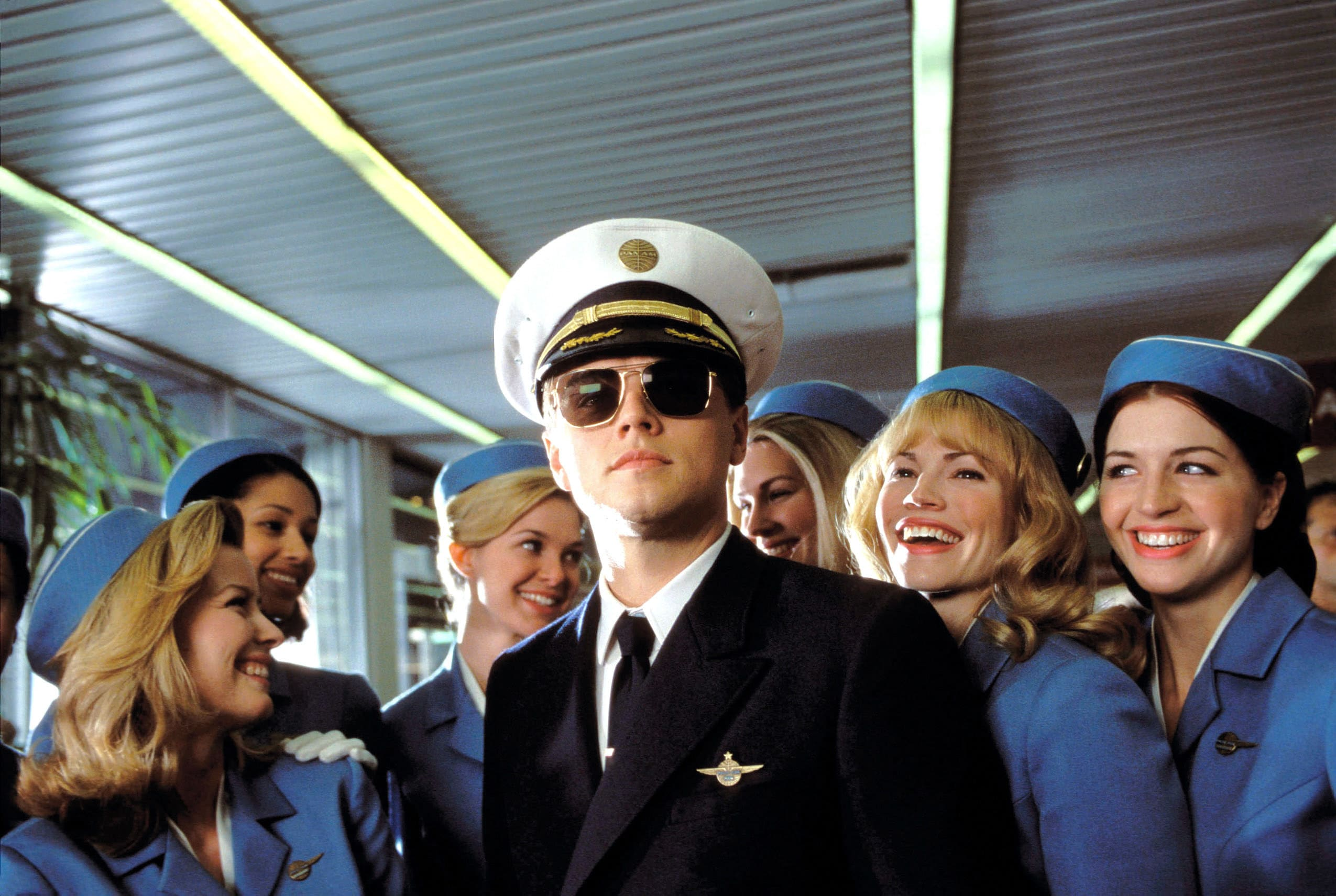 Leonardo DiCaprio as a pilot surrounded by flight attendents