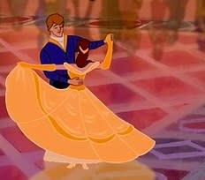 Bell dances with the prince in a gold ballgown