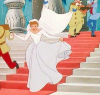 Cinderella wears a wedding dress and runs down stairs