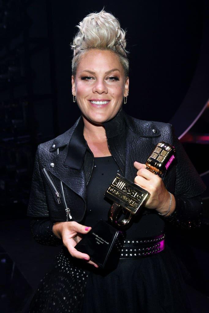 Pink holding an award