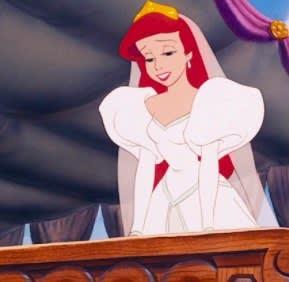 Ariel wears a wedding dress