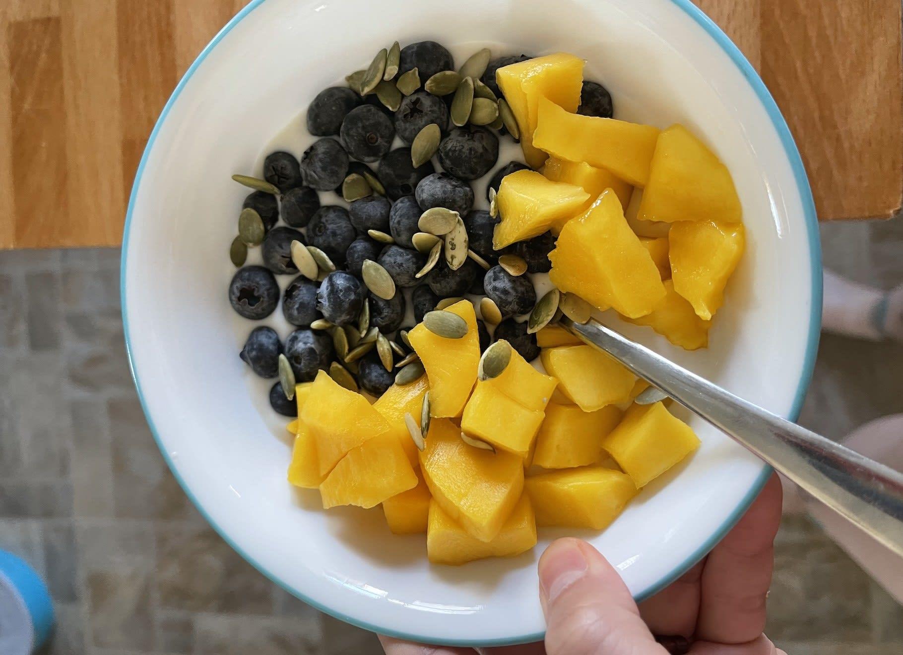 A bowl of fruit and yogurt