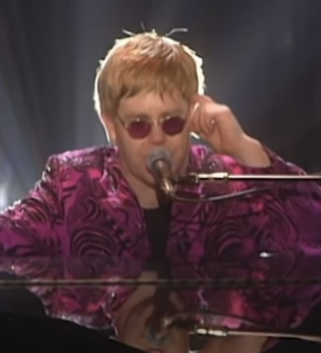 Elton performing the song at a show