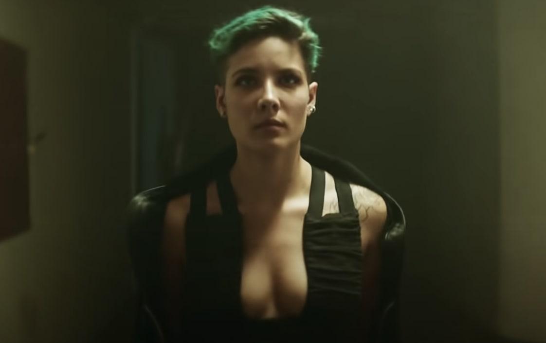 Halsey standing in her music video
