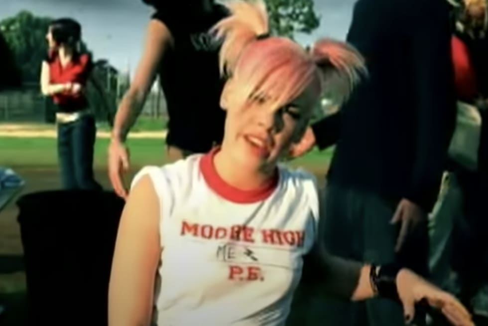Pink in pigtails on a field in the music video