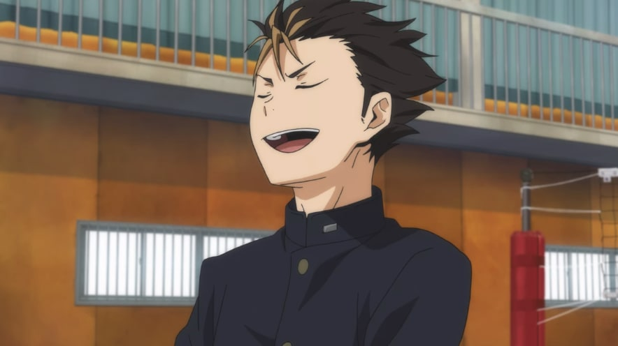 A male anime school student wearing a black military-style coat as their uniform