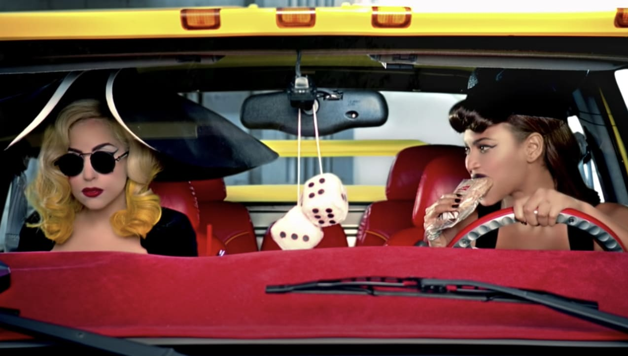Lady Gaga and Beyonce in a car in the music video