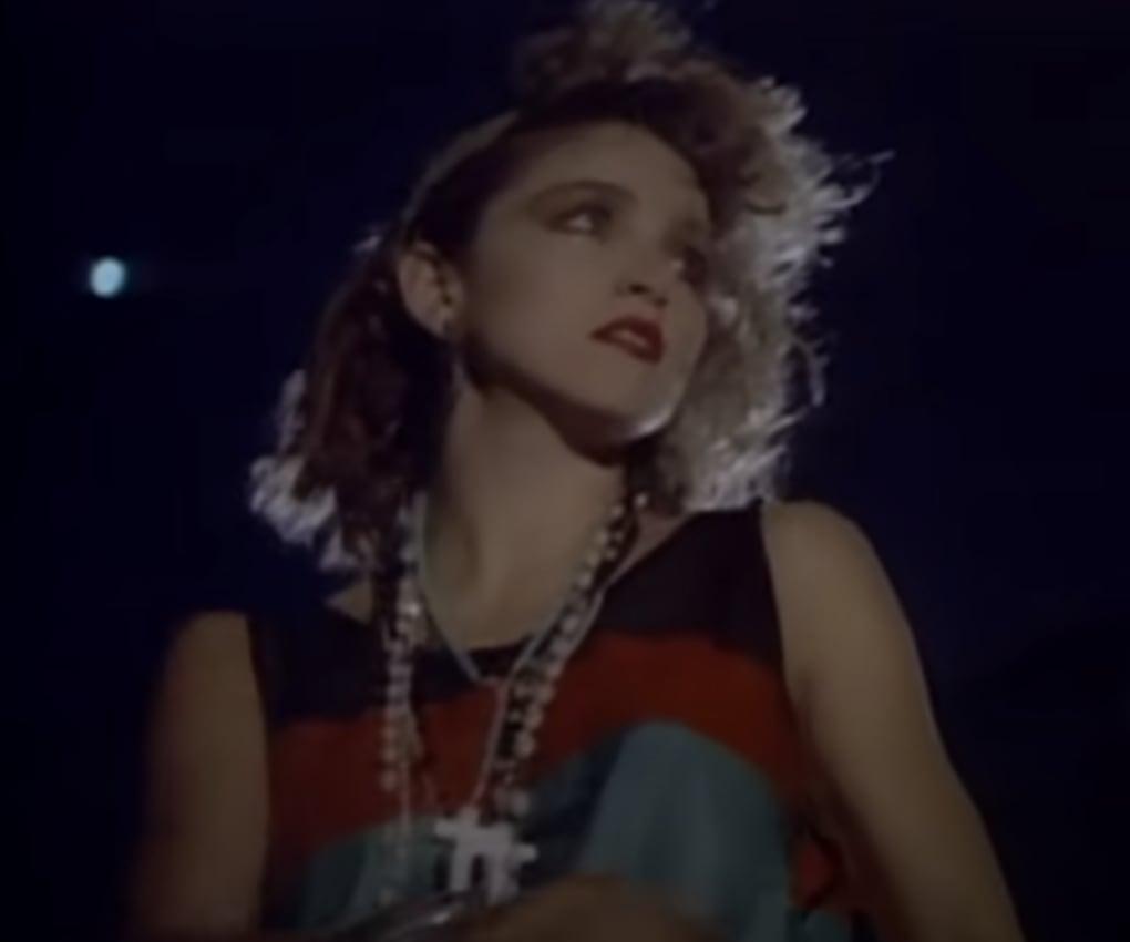 Madonna walking in her music video