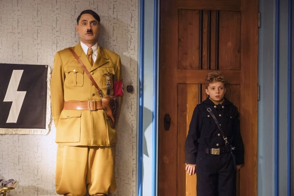 Hitler and Jojo standing against a wall