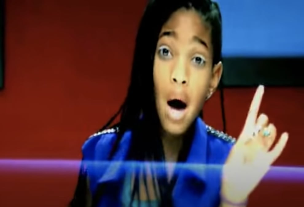 Willow in the music video with a finger up
