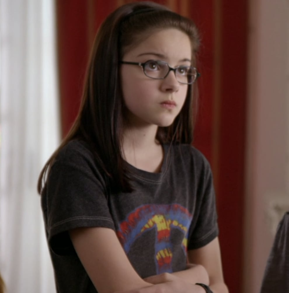 Young Ariel with dark hair and glasses as Alex