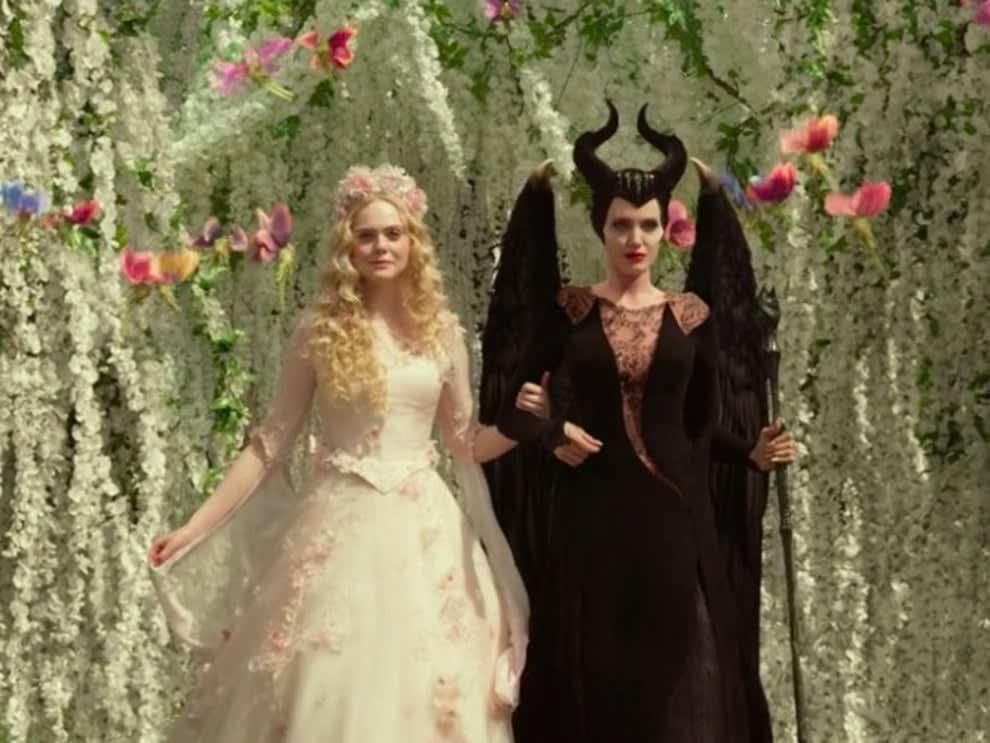 Live-action Aurora walks next to Maleficent in a wedding dress