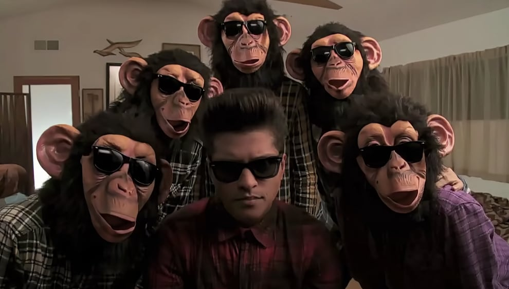 Bruno with people in monkey masks in the music video