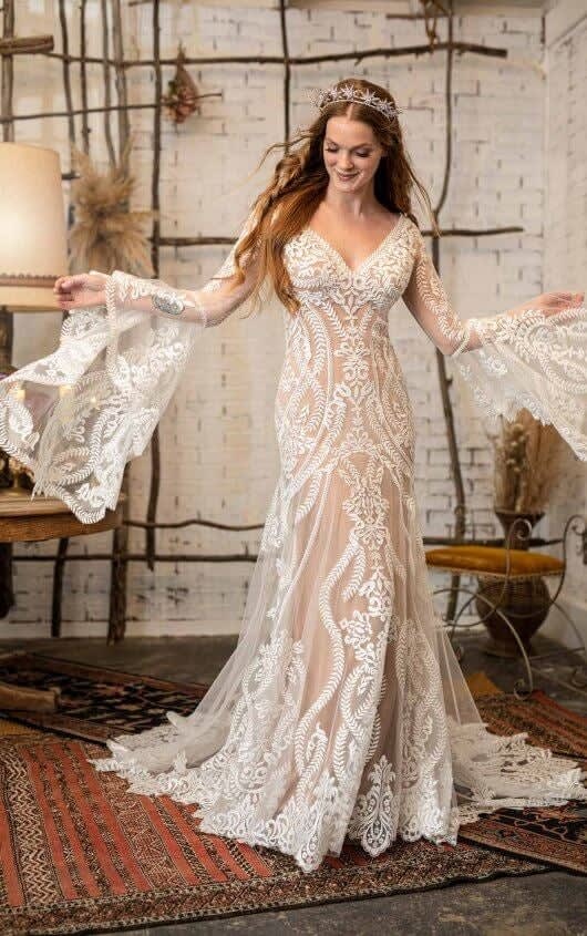 A dress with a b-neck, lacy overlay, and flared bell sleeves