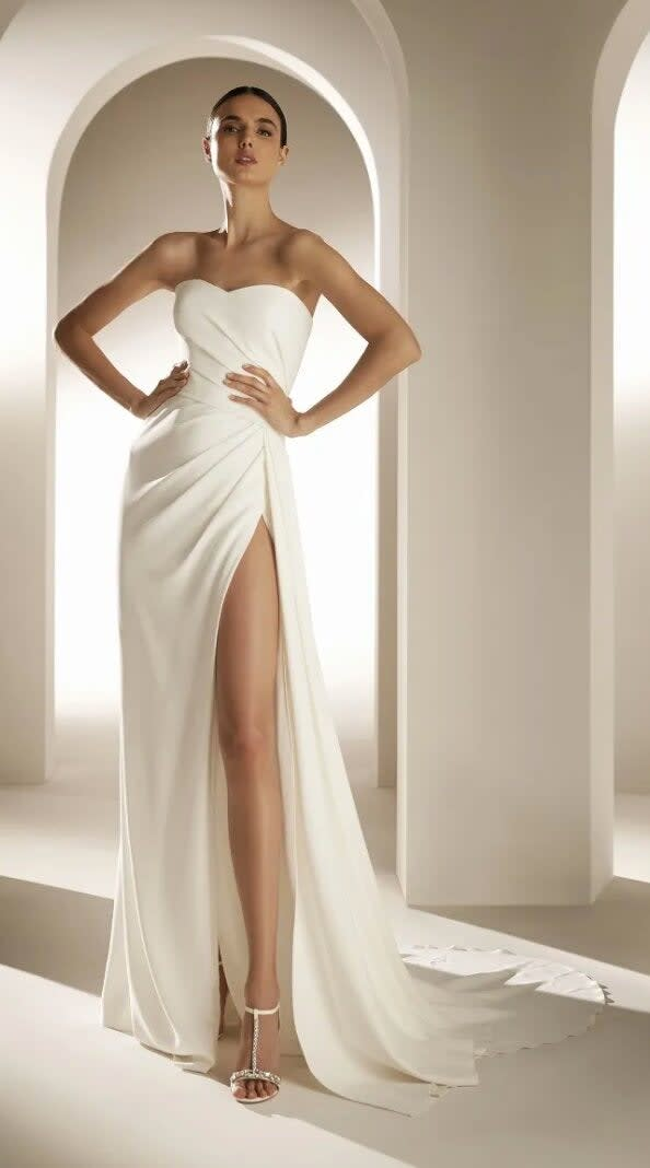 A strapless gown with a sweetheart neckline and a high slit