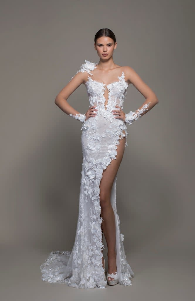 A long, illusion floral gown with a high slit