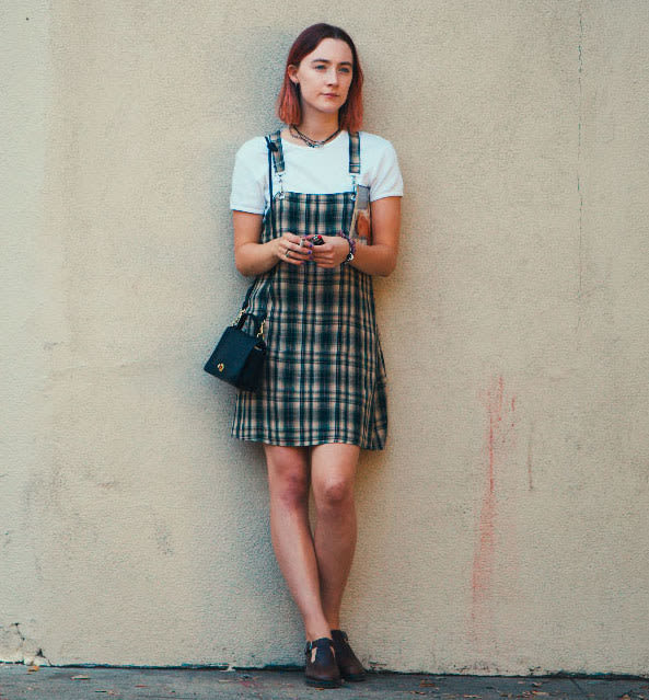 A plaid dress layered over a simple tee