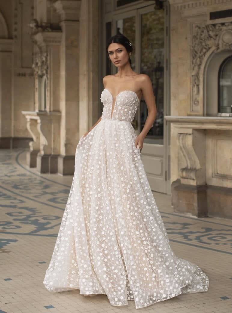 A strapless dress with a sweetheart neckline and floral tulle all over it