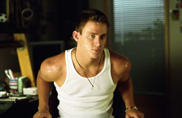 Duke Orsino wearing a tank top and sitting in a chair