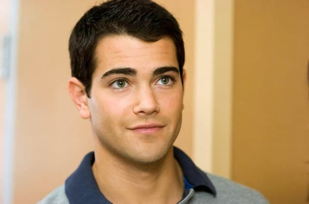 John tucker wearing a polo and grinning