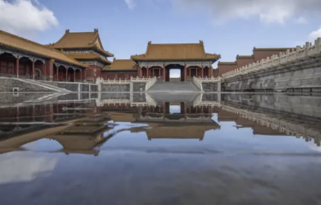 A giant city with Asian architecture, surrounded by water