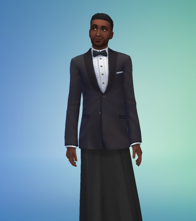 man with dark hair and brown eyes wearing a tuxedo dress