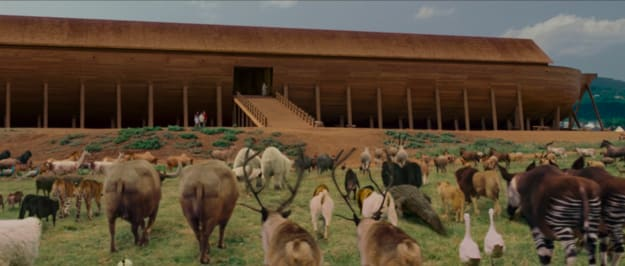 Animals walking in pairs to a large, wooden arc