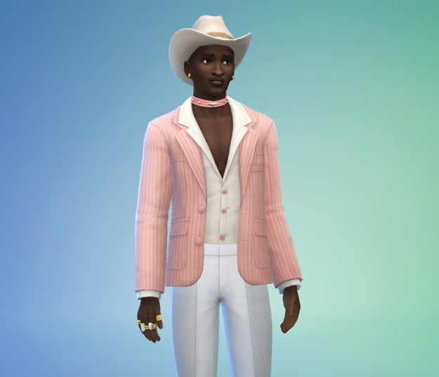 young man with a mustache, bold suit, and a cowboy hat
