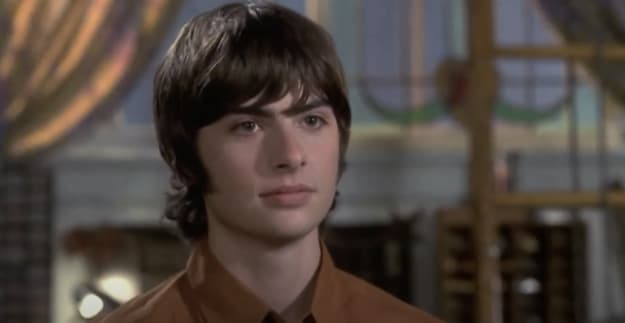 Michael Moscovitz wearing a collared shirt with a serious look on his face