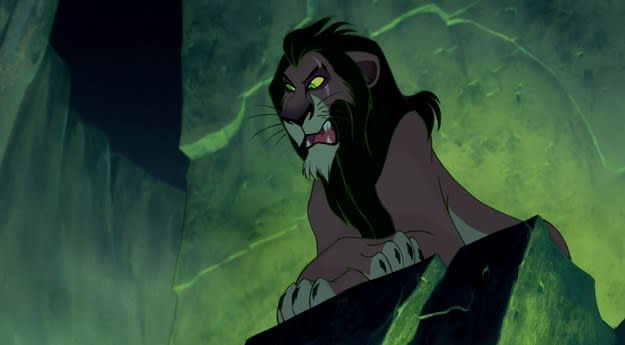 """Scar from """"The Lion King"""" sits on a high rock in a dark, green-tinged cave"""