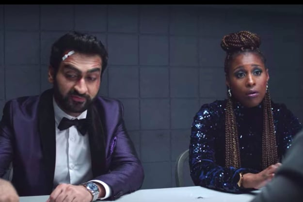 Scene where Jibran, played by Kumail Nanjiani, and Leilani, played by Issa Rae, are sitting in an interrogation room wearing evening wear