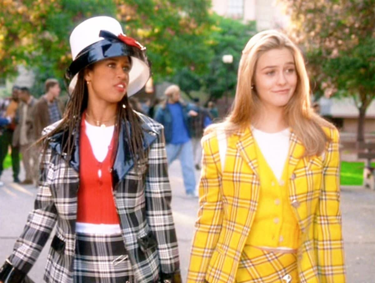 Cher and Dionne are walking to class wearing matching plaid suits