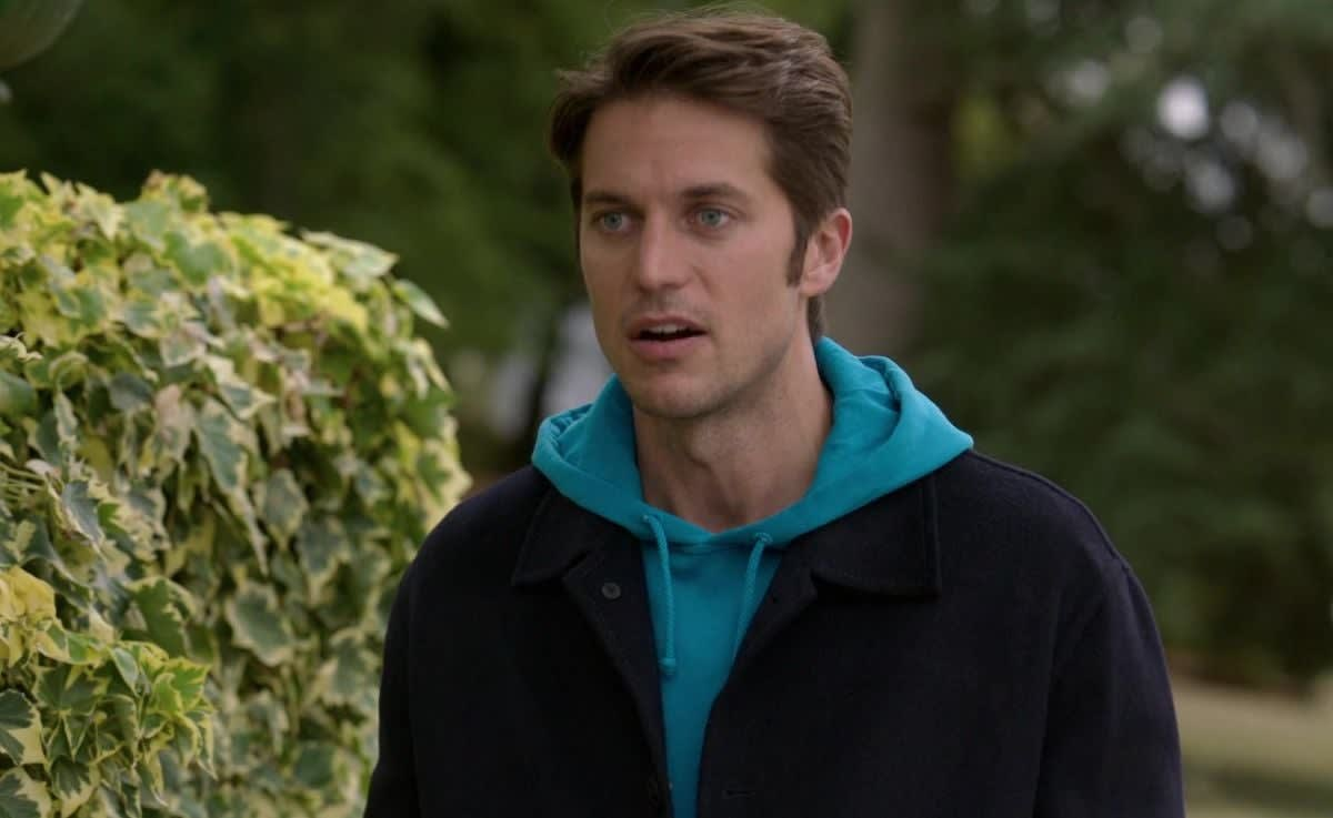 "Lucas Bravo takes a walk as Gabriel in ""Emily in Paris"""