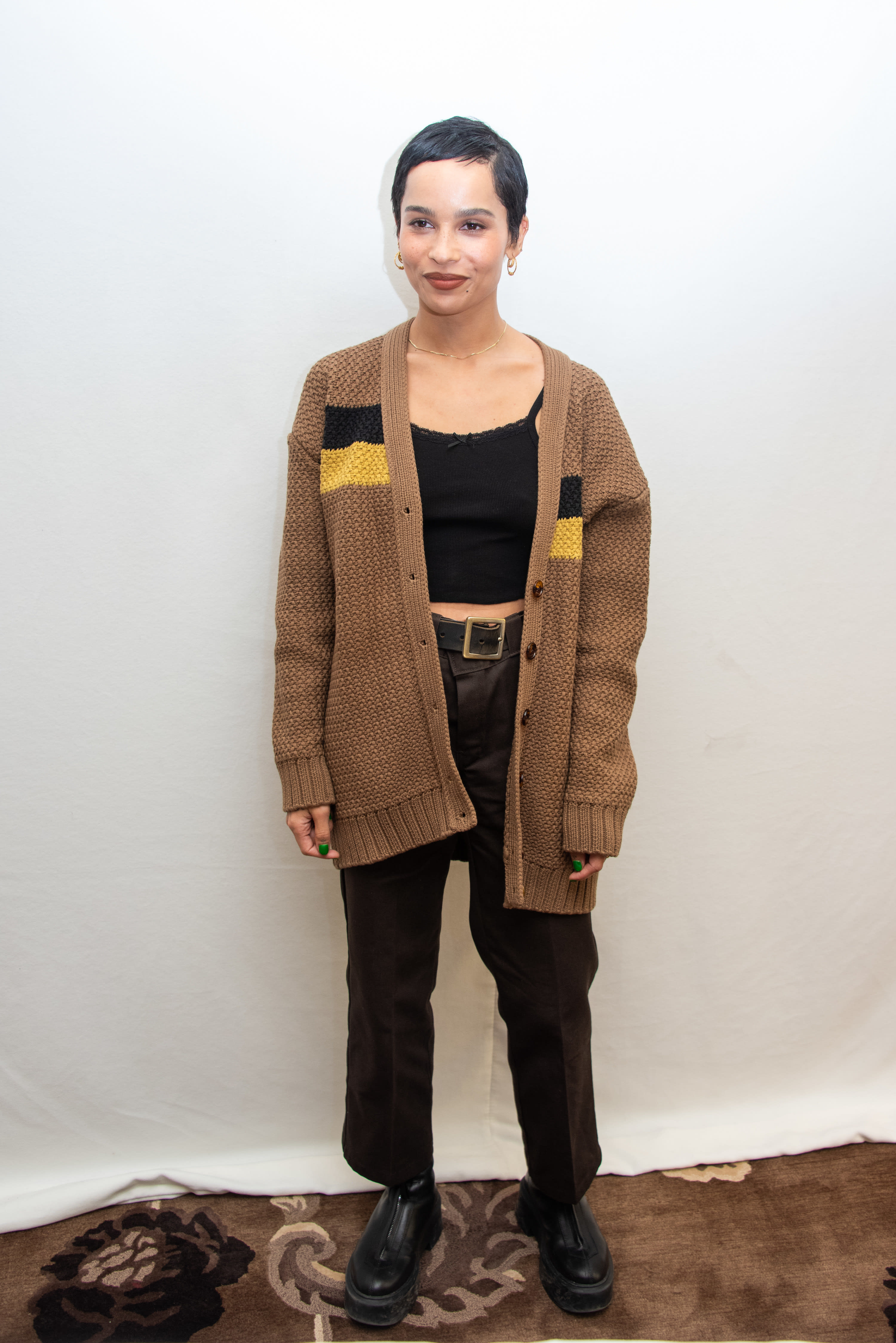 Zoe in jeans oversize cardi, tank and boots