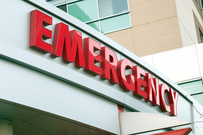 an emergency sign above a hospital entrance