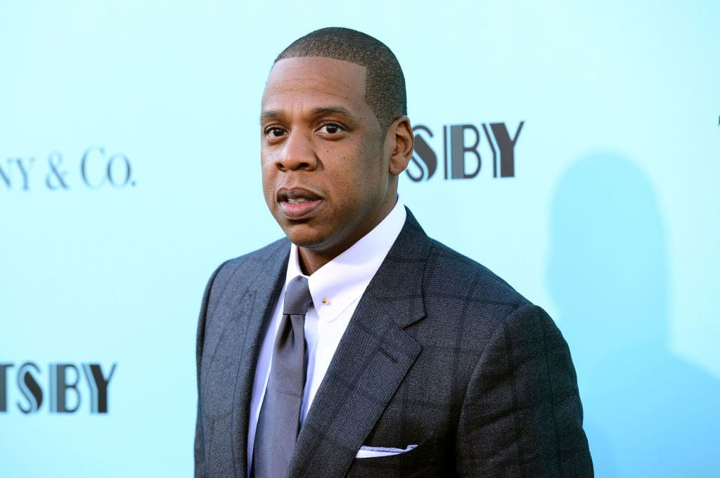 Jay-Z in a suit and tie