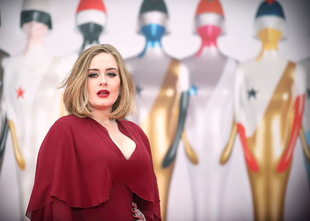 Adele attends the BRIT Awards 2016 in a v-cut gown